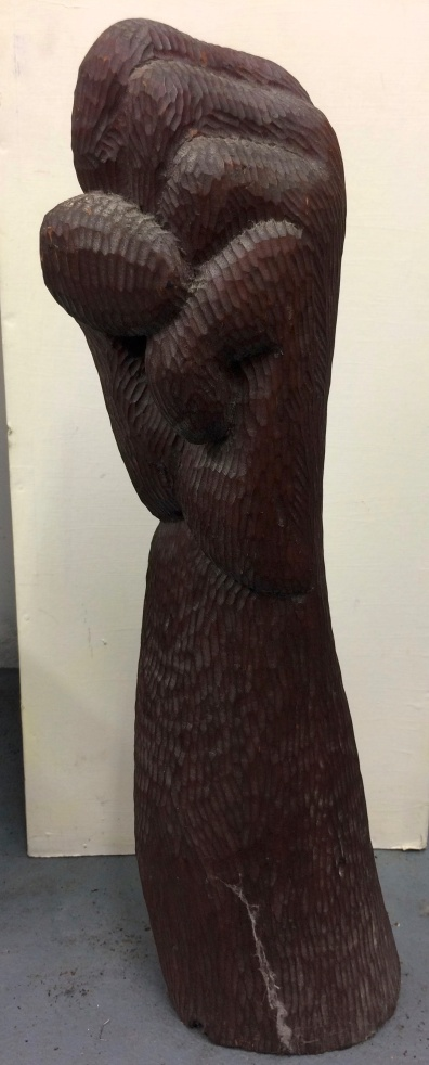 arm raised, stained elm 1988